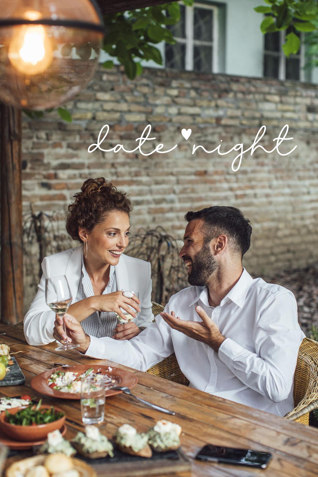 Couple Enjoying Wine and Food at Restaurant